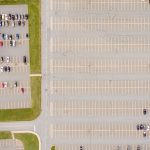Drone photo taken by Adrian Fish of cars in a parking lot.